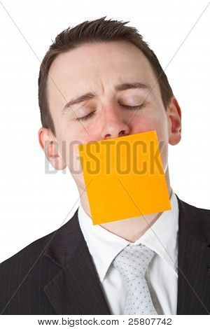 Businessman With A Blank  Adhesive Note Over His Mouth