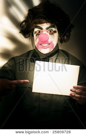 Circus Clown Holding Sign