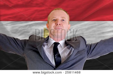 Happy Businessman Because Of Profitable Investment In Egypt Standing Near Flag