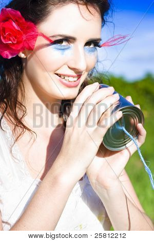 Woman Taking Into Vintage Phone