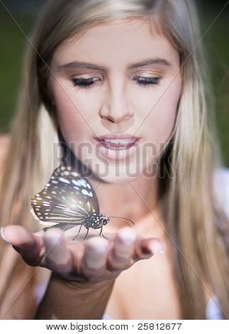 Woman Holding Butterfly
