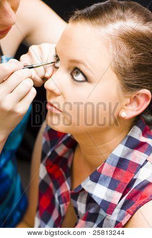 Bride Getting Eye Liner Makeup Applied