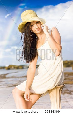 Young Woman Relaxing By The Sea
