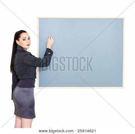 Woman Drawing Up Business Plan During Meeting