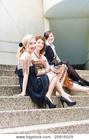 Three Young Attractive Woman Sitting On Steps