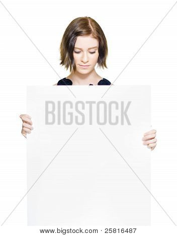 Woman Looking Down At Blank Sign