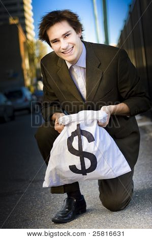 Happy Business Man Smiling With Money Bag