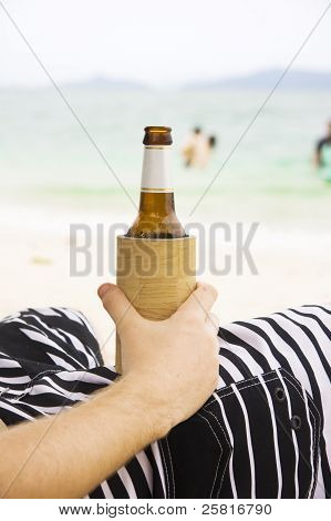 Person With Beer On Beach