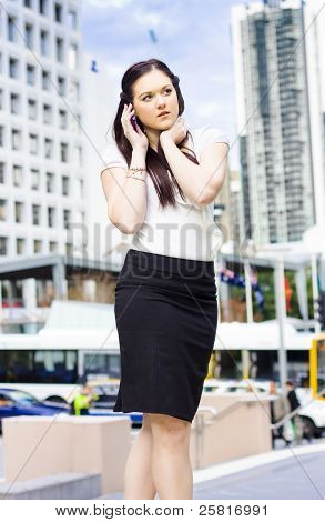 Business Person Talking On Mobile Phone In Street