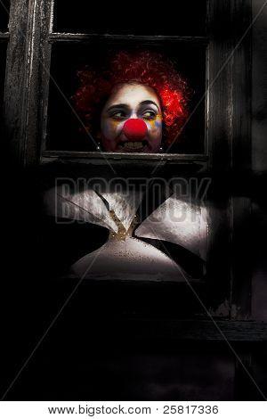 Head Of Clown In Dark Window