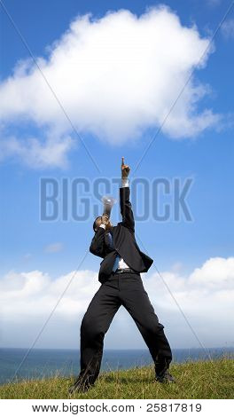 Businessman holding megaphone with pointing the cloud