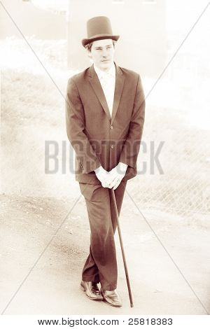 Vintage Man Standing On The Streets Of Yesterday