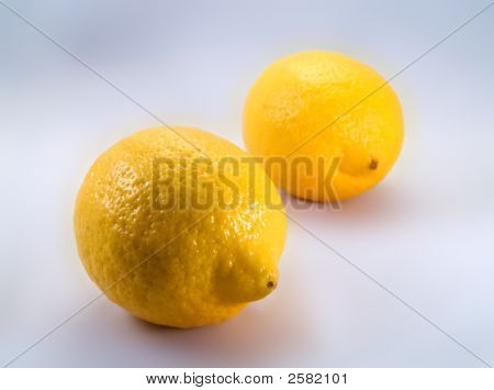 Two Lemons On A White Background