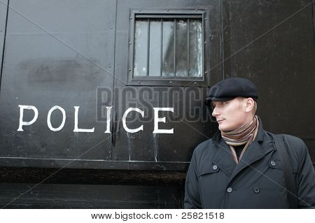 Man And Retro Police Carriage