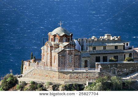 Greek Orthodox Church On A Rock Above The Sea
