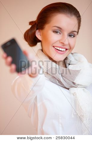 Portrait of young sexy brunette woman with mobile phone