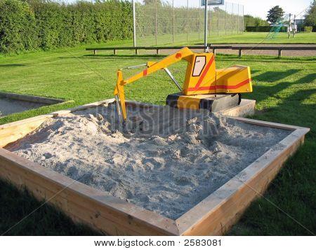 Toy Excavator In A Playground
