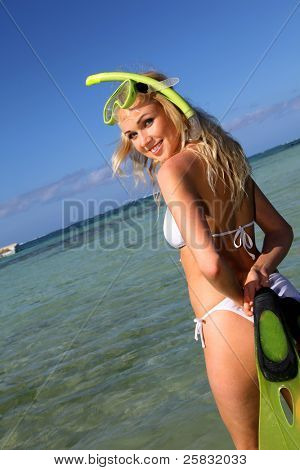 Smiling woman wearing snorkeling outfit