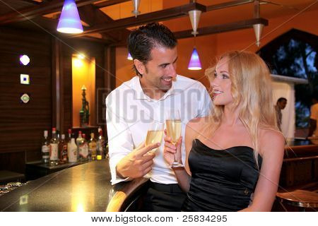 Couple drinking champagne in fancy bar