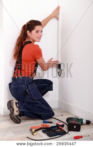 Woman covering an electrical wire