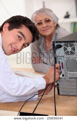 young man repairing a computer