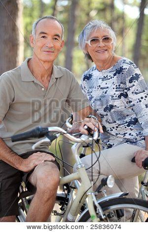 Elderly couple on bike ride