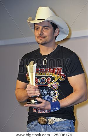 LAS VEGAS - APRIL 3 - Brad Paisley with the award for Top Male Vocalist in the press room at the 46th Annual Academy of Country Music Awards in Las Vegas, Nevada on April 3, 2011.
