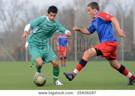 KAPOSVAR, HUNGARY - NOVEMBER 6: Unidentified players in action at the Hungarian National Championship under 17 game Kaposvar (white) vs. Nagybajom (blue) November 6, 2011 in Kaposvar, Hungary.