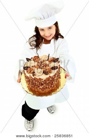 Adorable Girl Child In Chef Uniform Holding Caramel Pecan Cake