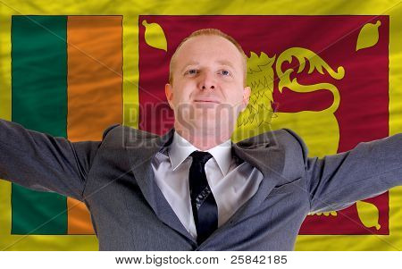 Happy Businessman Because Of Profitable Investment In Srilanka Standing Near Flag