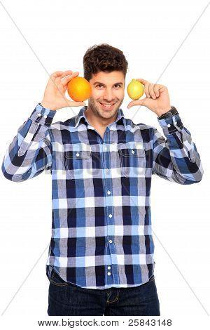 Man Holding Orange And Lemon
