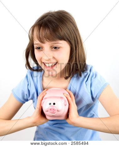 Smiling Girl With Piggy Bank