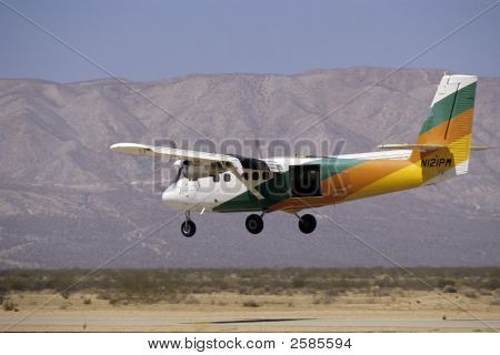 A twin engined aircraft lands on a
