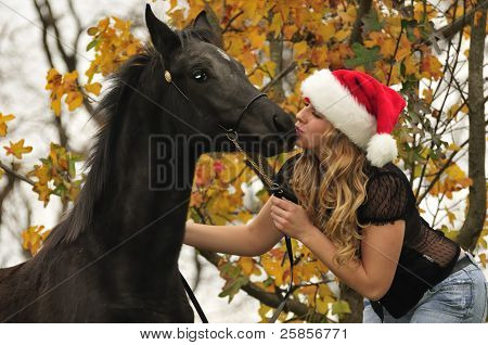 Pretty Girl Kissing A Horse