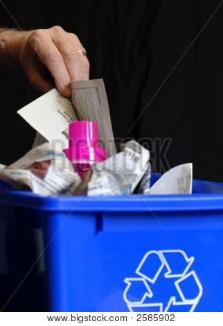 Putting Recycling In Bin