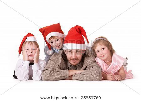 Family in Christmas caps