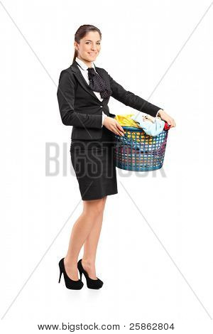 Full length portrait of a female in a suit holding a laundry basket isolated on white background