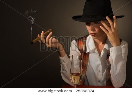 Beautiful Woman In A Black Hat With A Cigar