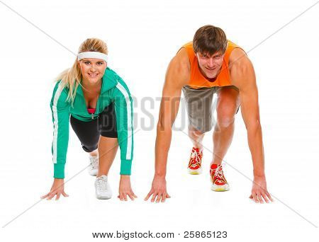 Healthy Young Man And Fit Female In Start Position Ready For Run Race Isolated On White