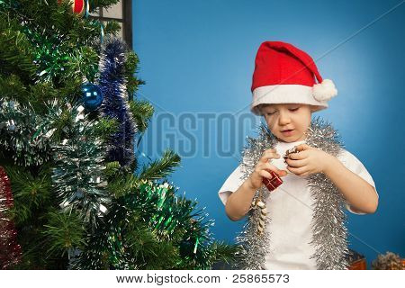 Boy Wearing Santa Claus Clothes With A New Year Gift