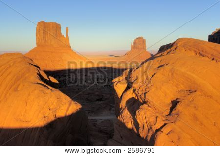 Boulders Framing Mittens In Monument Valley, Navajo Nation
