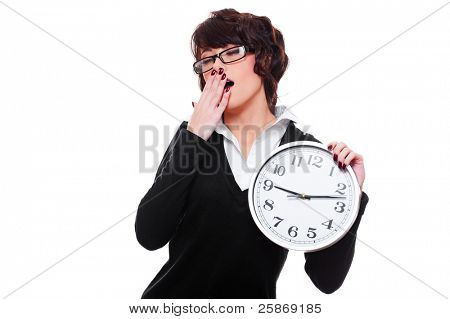 drowsy businesswoman holding clock and yawning. isolated on white background