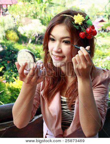 Beautiful Asian Woman Applying Make Up