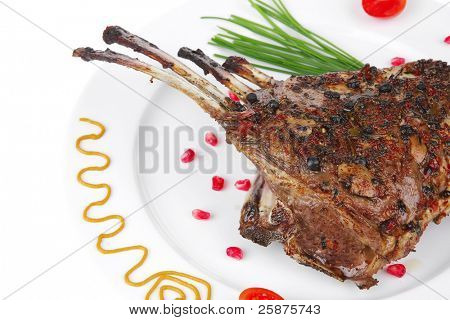 served grilled ribs rack over white plate
