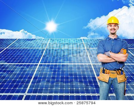 standing worker and solar panel background