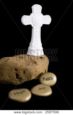 Cross On Rock With Inspirational Stones