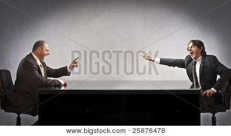 Two businessmen quarreling