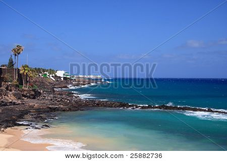 A coastal scene with a breakwater in Costa Teguise, Lanzarote