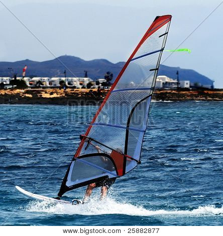 A windsurfer sailing off Lanzarote, Canary Islands
