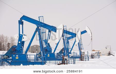 Pumpjacks Working An Oil Field In Central Alberta In The Winter